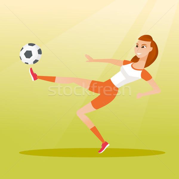 Młodych piłkarz piłka gry Zdjęcia stock © RAStudio