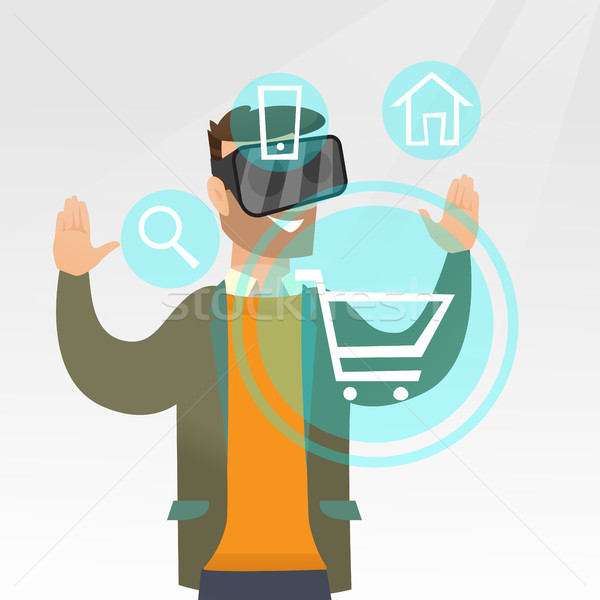 Man in virtual reality headset shopping online. Stock photo © RAStudio