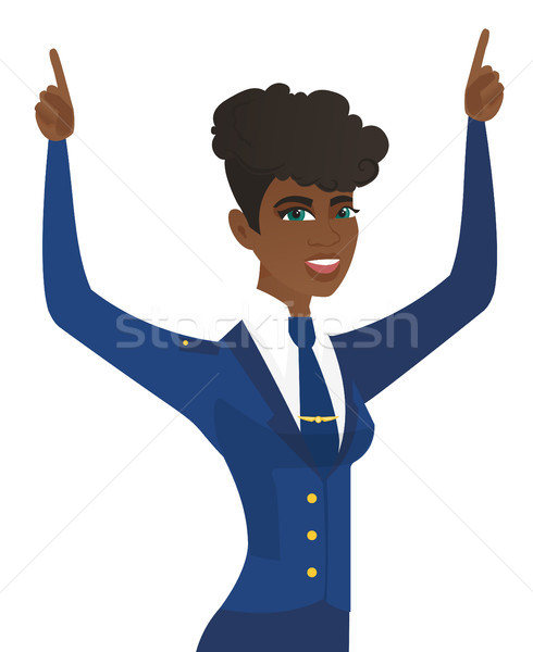 African stewardess standing with raised arms up. Stock photo © RAStudio