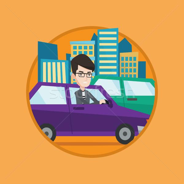 Angry caucasian man in car stuck in traffic jam. Stock photo © RAStudio