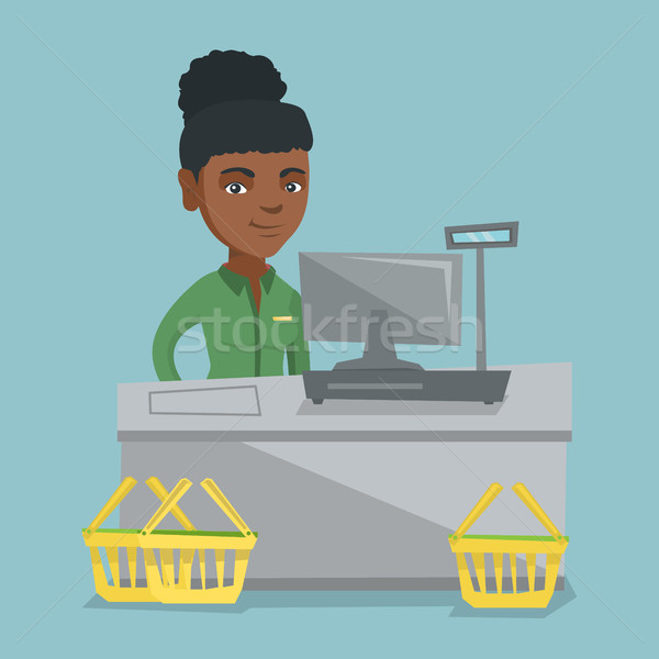 Cashier standing at the checkout in a supermarket. Stock photo © RAStudio