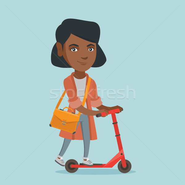 Young african business woman riding kick scooter Stock photo © RAStudio