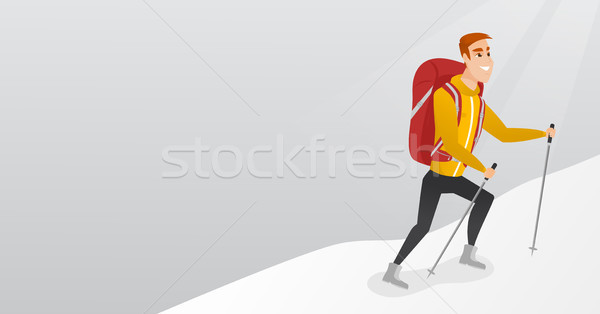 Caucasian mountaineer climbing a snowy ridge. Stock photo © RAStudio