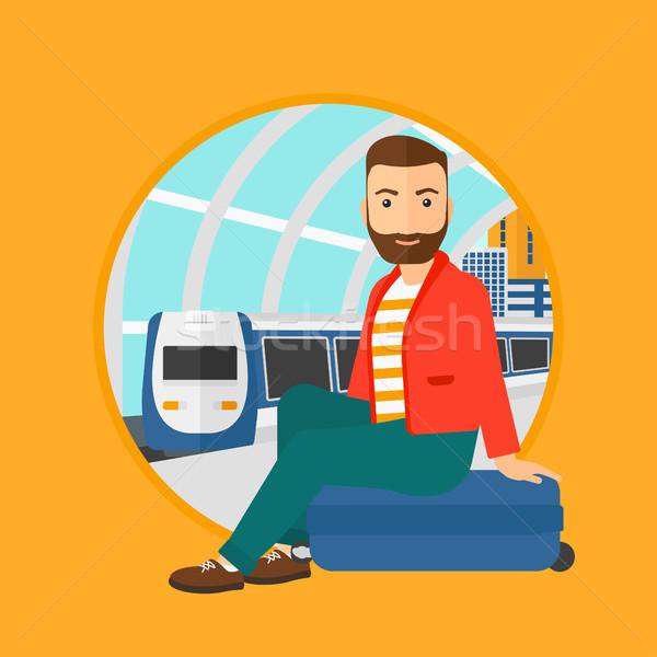 Homme séance valise gare barbe Photo stock © RAStudio
