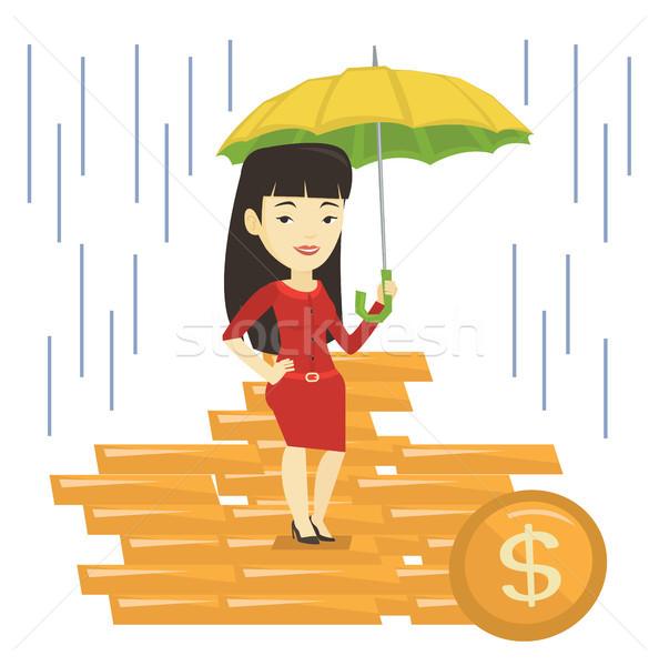 Business woman insurance agent with umbrella. Stock photo © RAStudio