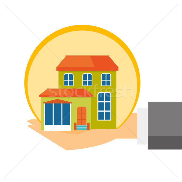 Insurance agent hands with the model of house. Stock photo © RAStudio