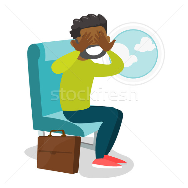 African-american man suffering from aerophobia. Stock photo © RAStudio