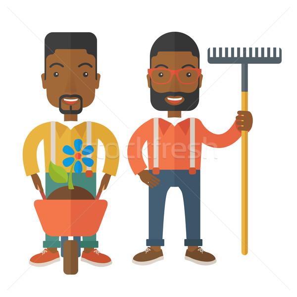 Kettő fekete férfiak talicska gereblye mosolyog Stock fotó © RAStudio