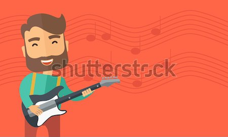 Musician is playing electrical guitar Stock photo © RAStudio