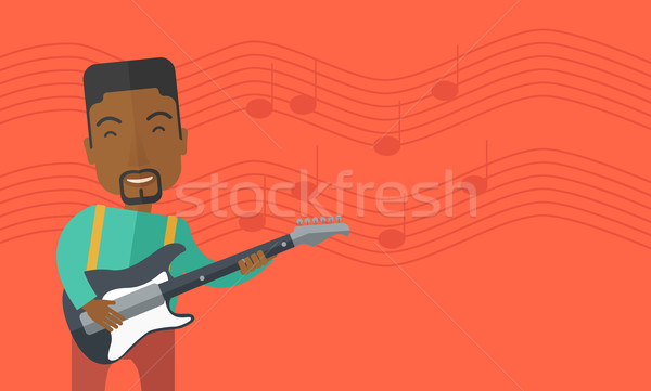 Stock photo: Musician playing electric guitar.