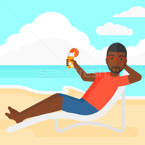 Man sitting in chaise longue. Stock photo © RAStudio