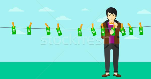 Man loundering money. Stock photo © RAStudio