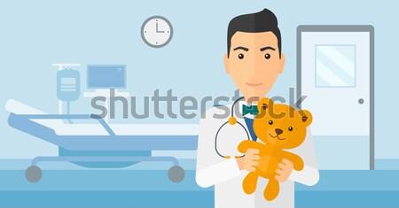 Pediatrician holding teddy bear. Stock photo © RAStudio
