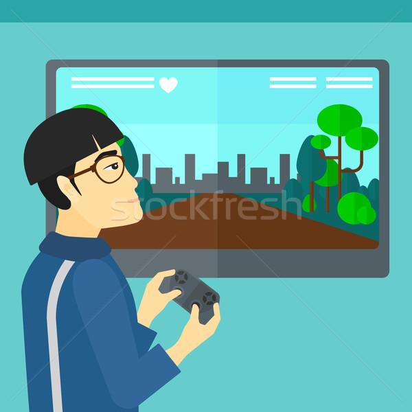 Homem jogar jogo vídeo asiático gamepad mãos Foto stock © RAStudio