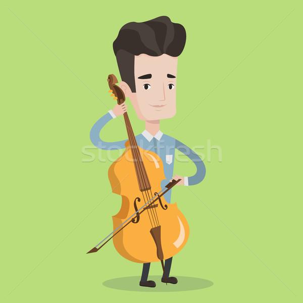 Homme jouer violoncelle jeune homme violoncelliste musique classique Photo stock © RAStudio