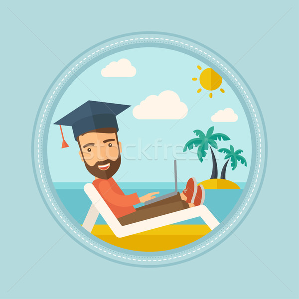 Stock photo: Graduate lying in chaise lounge with laptop.