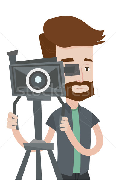 Stock photo: Cameraman with movie camera on tripod.