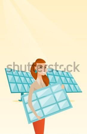 Woman holding solar panel vector illustration. Stock photo © RAStudio