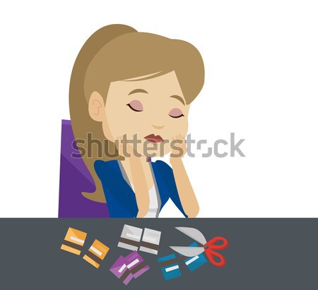 Businesswoman bankrupt cutting his credit card. Stock photo © RAStudio
