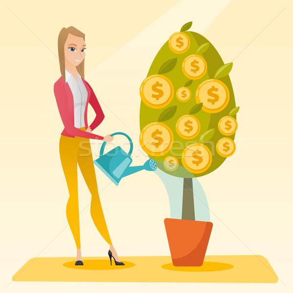 Nő locsol pénzfa kaukázusi üzletasszony fiatal Stock fotó © RAStudio