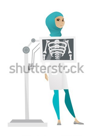 Stock photo: Caucasian roentgenologist during x ray procedure.