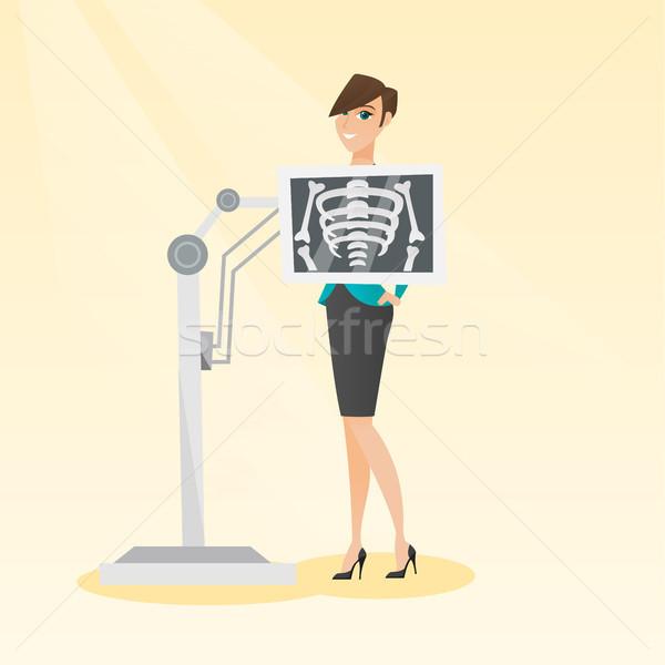 Pacjenta rentgenowskiego procedura młodych kobieta Zdjęcia stock © RAStudio