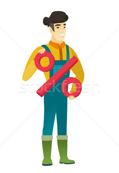 Smiling farmer holding percent sign. Stock photo © RAStudio