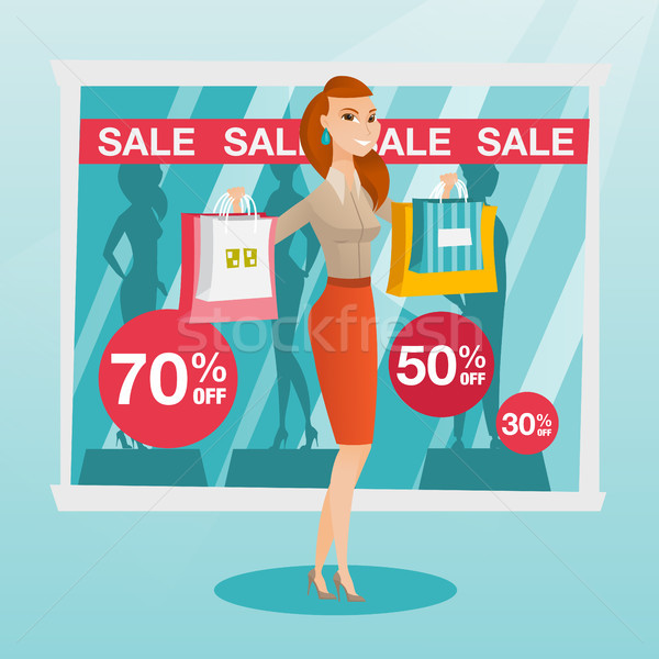 Young caucasian woman shopping on sale. Stock photo © RAStudio