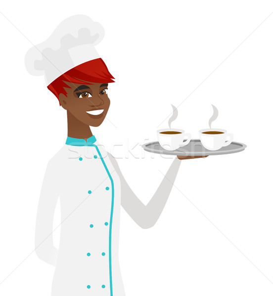 Young african-american chef holding tray with cups Stock photo © RAStudio