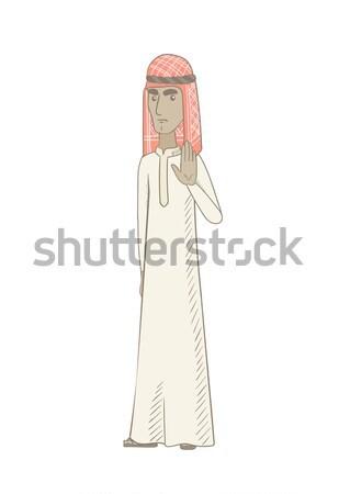 Young muslim man showing palm hand. Stock photo © RAStudio