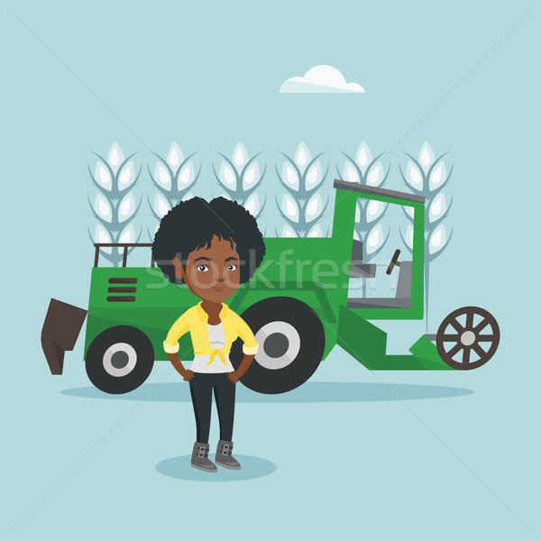 Farmer standing on the background of combine. Stock photo © RAStudio