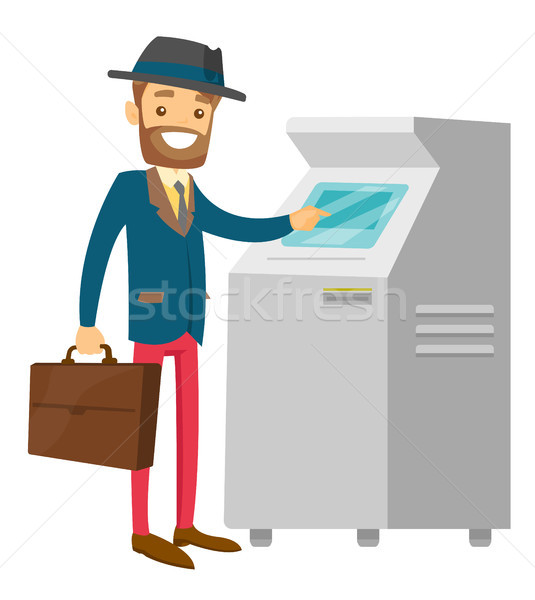 Caucasian white man using ATM for cash withdrawal. Stock photo © RAStudio