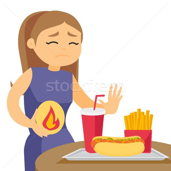 Sad caucasian white woman suffering from heartburn Stock photo © RAStudio