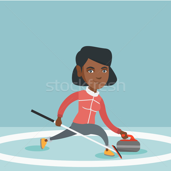 Sportswoman playing curling on a skating rink. Stock photo © RAStudio