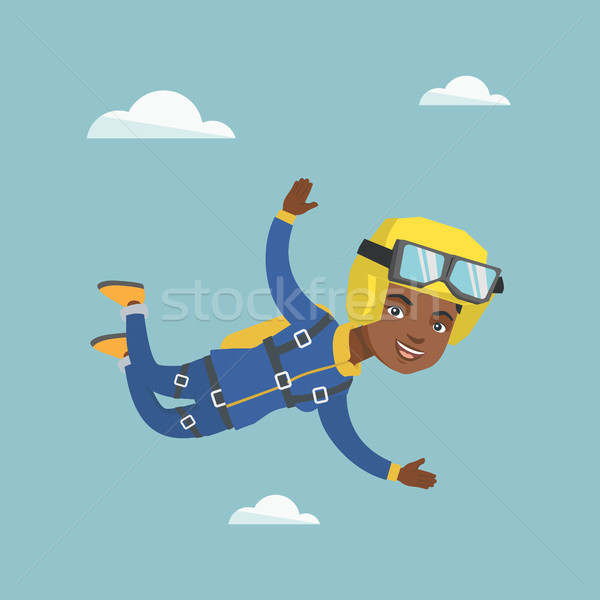 African parachutist jumping with a parachute. Stock photo © RAStudio