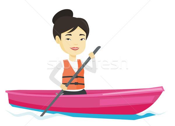 スポーツウーマン ライディング カヤック 小さな アジア 女性 ストックフォト © RAStudio