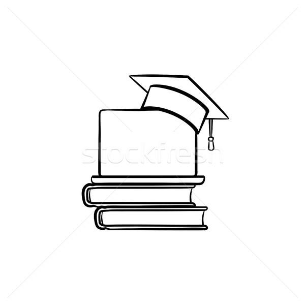 Graduation cap on book and laptop hand drawn icon. Stock photo © RAStudio