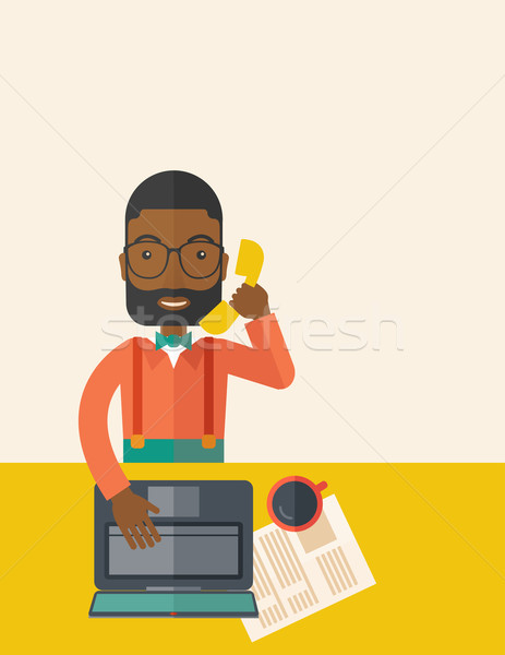 African Office man sitting at his working desk. Stock photo © RAStudio