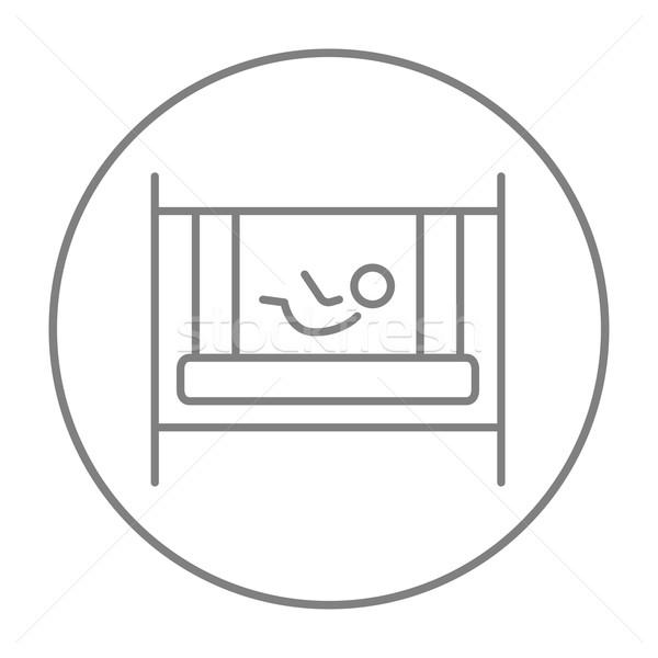 Baby laying in crib line icon. Stock photo © RAStudio