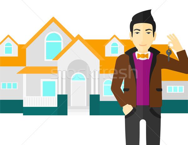 Agente immobiliare chiave asian casa vettore Foto d'archivio © RAStudio