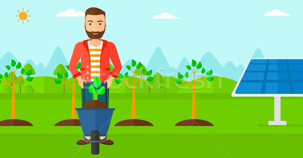 Homem planta carrinho de mão barba em pé Foto stock © RAStudio
