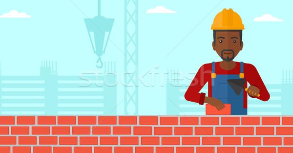 каменщик кирпичных рук строительная площадка вектора Сток-фото © RAStudio