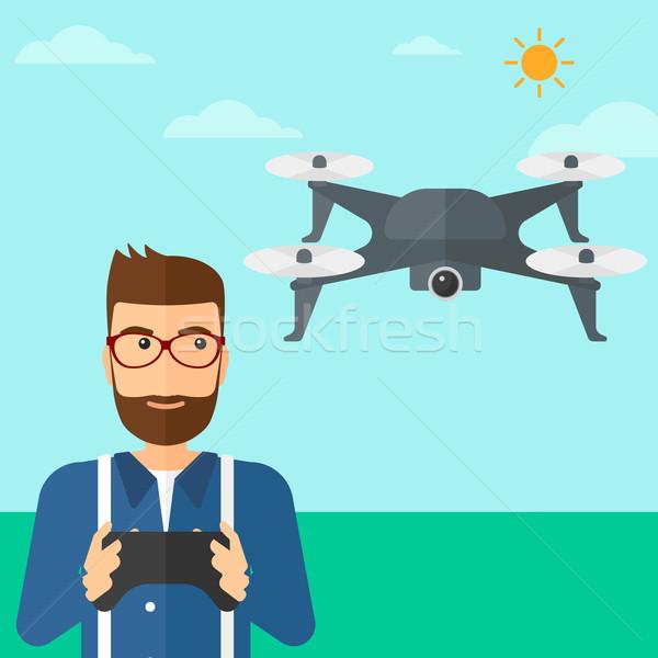Man flying drone. Stock photo © RAStudio