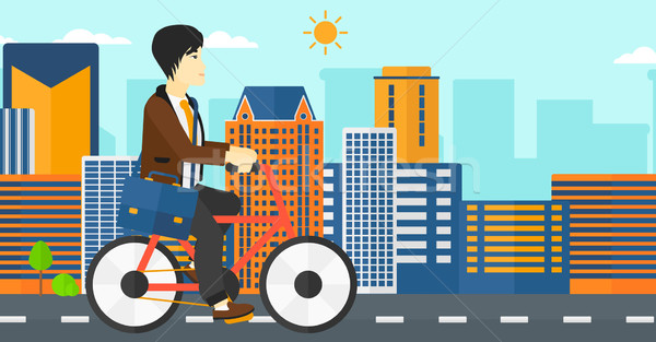 Stock photo: Man cycling to work.