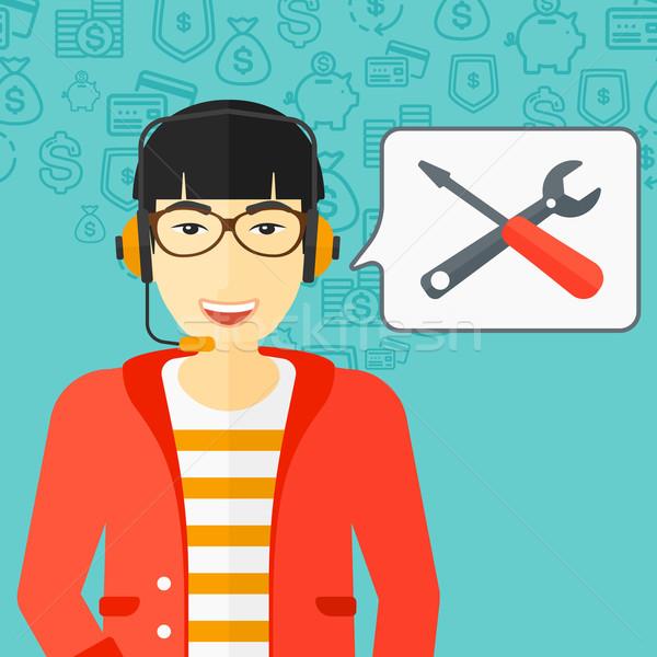 Exploitant technische ondersteuning asian hoofdtelefoon ingesteld toespraak Stockfoto © RAStudio