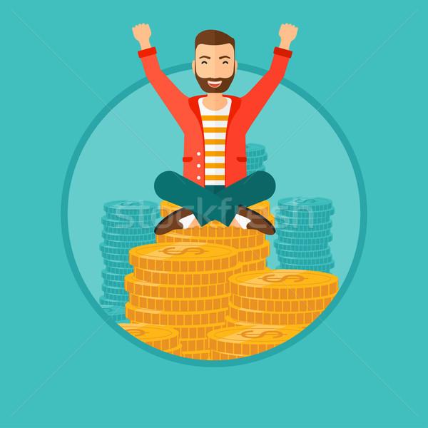 Feliz empresario sesión monedas hombre Foto stock © RAStudio