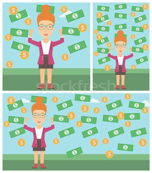 Happy business woman under money rain. Stock photo © RAStudio