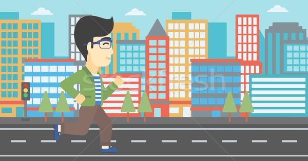 молодым человеком работает азиатских мужчины Runner бег Сток-фото © RAStudio