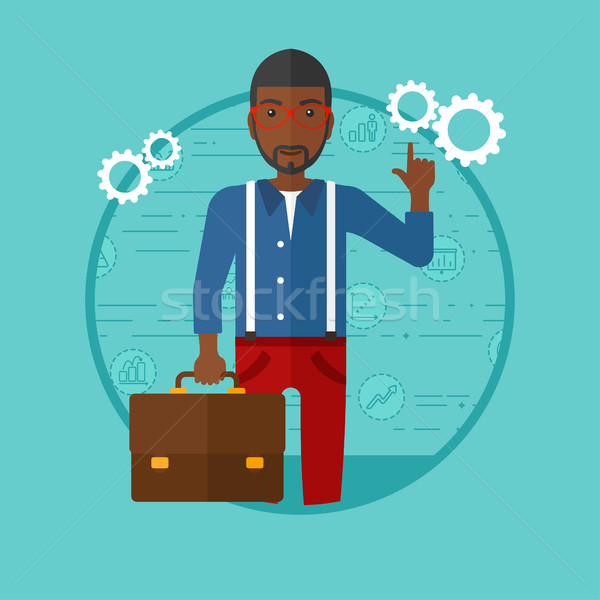 Biznesmen wskazując teczki stałego niebieski Zdjęcia stock © RAStudio