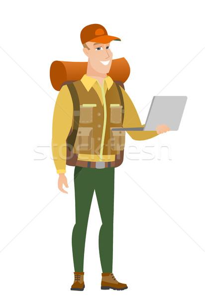 Traveler using laptop vector illustration. Stock photo © RAStudio